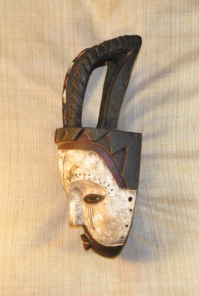 African Kwele Mask and African Sculptures